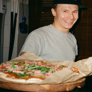 Man holding pizza out